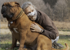 pets and your mental health - image of woman hugging large dog